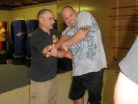 GM Chris Petrilli (doce Pares) with Howard Scrivens (San Soo)