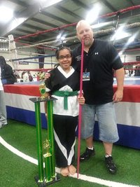 Ms. Delos Reyes after winning Grand Champion at GM Forts tournament